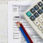Tax Document, calculator and and pencils