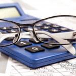 Calculator and glasses on desk